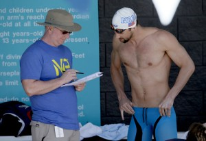 Michael Phelps talks with coach Bob Bowman prior to competing, Thurs. April 16, 2015  (AP Photo/Matt York)